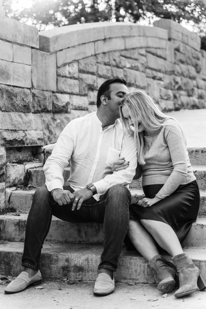 black and white photo where husband is kissing his wife